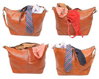 Set of handbags with female and male clothes Royalty Free Stock Photos