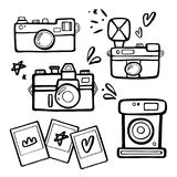 Set of handdrawn retro photo cameras illustrutions. Vintage photo cameras icons. Set of hand drawn photo cameras illustrutions. Vintage photo cameras with photo Royalty Free Stock Photo