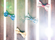 Set of handmade bow tie over wooden background Royalty Free Stock Images