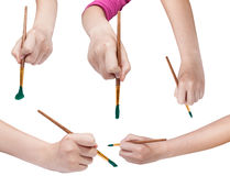 Set of hands with art paintbrushes with green tips Stock Photo