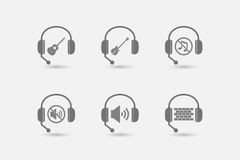 Set of hands free headsets with  sound and music related icons Stock Image