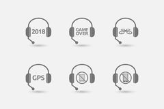 Set of hands free headsets with  technology related icons Stock Images