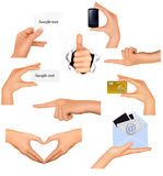 Set of hands holding different business objects. Stock Photos