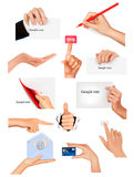 Set of hands holding different business objects Stock Photography