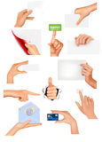 Set of hands holding different business objects. Stock Photo