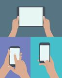 Set of hands holding digital tablet and mobile phone. Royalty Free Stock Photos