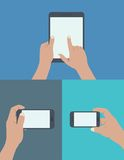 Set of hands holding digital tablet and mobile phone. Flat design style modern  illustration. set of hands holding digital tablet and mobile phone with blank Royalty Free Stock Image