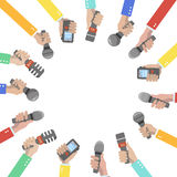 Set of hands holding microphones and voice recorders. Stock Image