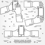 Set of hands holding mobile phone.Thin line icon. Vector illustr Stock Images