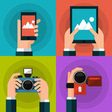 Set of hands holding smart phone, tablet, video Royalty Free Stock Images