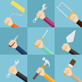 Set of hands holding tools. Royalty Free Stock Photos