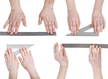 Set of hands with metallic rulers isolated Royalty Free Stock Image