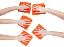 Set of hands with orange microfibre rags isolated Stock Photos