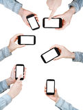 Set of hands is shirt holding smart phones Royalty Free Stock Photo
