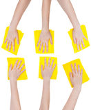 Set of hands with yellow fabric rags isolated Royalty Free Stock Image