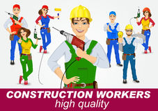 Set of handymen and handywomen with drills Stock Photos