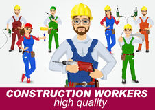 Set of handymen and handywomen with drills Royalty Free Stock Photo