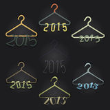 Set of 7 Hangers with Numerals Hanging: 2015. Black backdrop. Clever design for celebrating the year to come 2015in the form of numerals on hangers, this can royalty free illustration