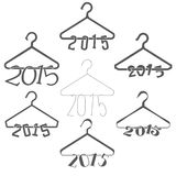 Set of 7 Hangers with Numerals Hanging: 2015. Isolated on white. Royalty Free Stock Images