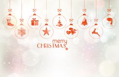 Set of hanging Christmas baubles over silver background  Stock Photos