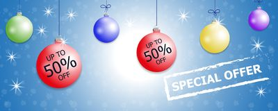 Set hanging colorful Christmas balls and discount. Decorative baubles elements on blue background for holiday sale design. Vector Royalty Free Stock Photo