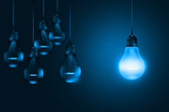 Set of hanging realistic bulbs in blue shade Stock Image