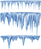 Set of hanging thawing icicles of a blue shade Royalty Free Stock Photography