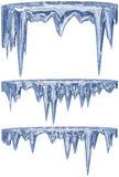 Set of hanging thawing icicles of a blue shade Stock Photos