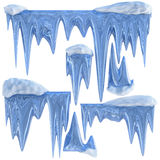 Set of hanging thawing icicles of a blue shade Royalty Free Stock Images
