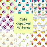 Set of hand drawn vector seamless patterns with cupcakes Royalty Free Stock Photos