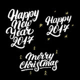 Set of Happy New Year 2017 and Merry Christmas hand written lettering. Modern brush calligraphy. Christmas greeting card on black background. Golden design Royalty Free Stock Images