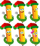 Set of happy pencils with Christmas wreath and Santa hat Royalty Free Stock Images