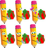 Set of happy pencils giving you a gift box Royalty Free Stock Images