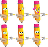 Set of happy pencils holding pen and papers Royalty Free Stock Photography