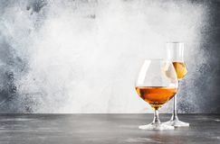 Set of hard strong alcoholic drinks and spirits in glasses in assortment: vodka, cognac, brandy and whiskey, grappa. Gray bar. Counter background, selective royalty free stock photos