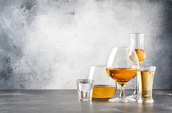 Set of hard strong alcoholic drinks and spirits in glasses in assortment: vodka, cognac, tequila, brandy and whiskey, grappa,. Liqueur, vermouth, tincture, rum royalty free stock images