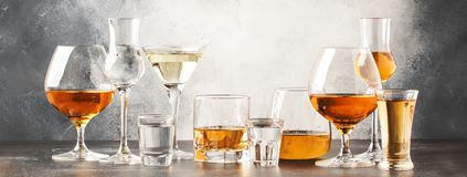Set of hard strong alcoholic drinks and spirits in glasses in assortment: vodka, cognac, tequila, brandy and whiskey, grappa,. Liqueur, vermouth, tincture, rum stock images