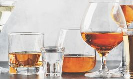 Set of hard strong alcoholic drinks and spirits in glasses in assortment: vodka, cognac, tequila, brandy and whiskey, grappa,. Liqueur, vermouth, tincture, rum royalty free stock photography