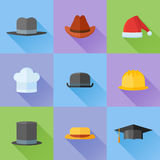 Set of hats flat icons with long shadow. Vector illustration. Set of hats flat icons with long shadow. Safety helmet, bowler, top hat, graduation cap, chef Royalty Free Stock Photography