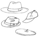 Set of hats hand drawn. Objects isolated on white. Set of fashion hats. Fedora, trilby, barret and baseball cap hand drawn. Objects sisolated on white Stock Images