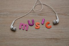 A set of head phones with the word music stock images