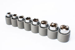 Set of heads for screwdriver in grey box isolated on white backg Royalty Free Stock Photo