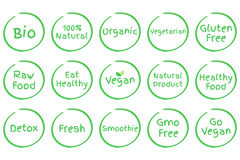 Set of Healthy Food vector symbols. Vegan, Bio, Organic, Fresh etc. Set of Healthy Food Symbols. Vector Bio 100% Natural Organic Vegetarian Gluten Free Raw Food Stock Photos