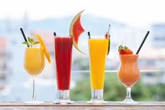 Set of healthy smoothies made of tomato, orange, watermelon, mango Stock Images