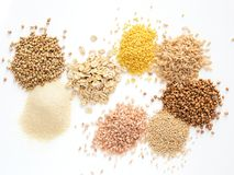 Set of heap various grains and cereals isolated. Set of heap various grains and cereals - raw green buckwheat, semolina, oat flakes, millet, brown rice stock photos