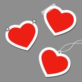 Set of heart tags with pins, tape and thread Stock Images