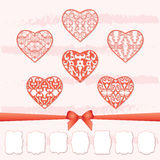 A set of hearts and a collection of frames of different shapes by cutting out paper. Stock Photography