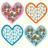 Set of hearts. With decorative flowers Stock Images