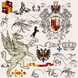 Set of  heraldic design  elements with shield, crown, griffin an Stock Photos