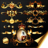 Set of heraldic elements. Set of ornamental golden heraldic elements, this illustration may be useful as designer work Royalty Free Stock Photo